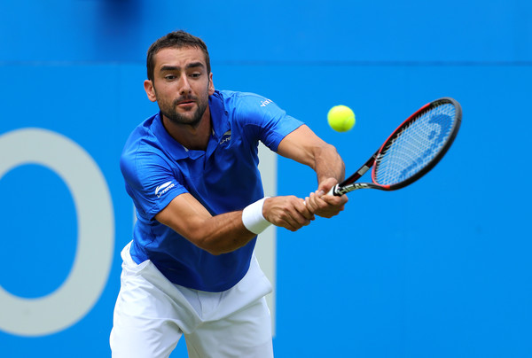 Marin Cilic lunges for a backhand on Friday at the Queen's Club. Photo: Richard Heathcote/Getty Images