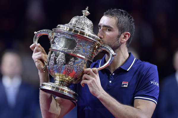 Marin Cilic hoists the Basel trophy. Photo: Harold Cunningham/Getty Images