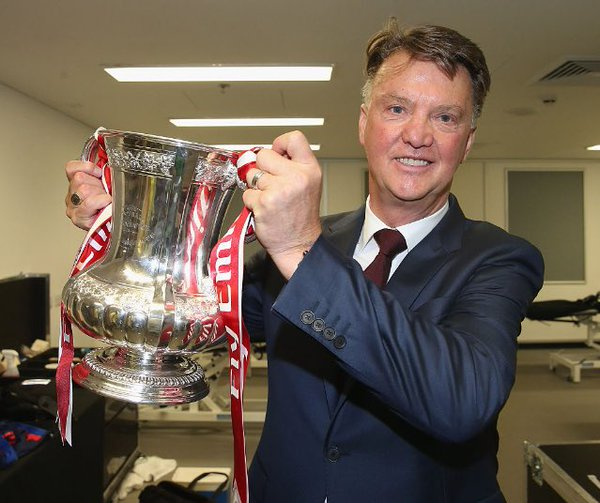 van Gaal with the FA Cup after United beat Crystal Palace | Photo: Getty