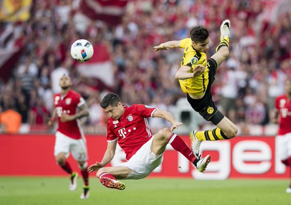Lewandowski (left) just couldn't find the target against his former club in a well-contested final. (Photo: Borussia Dortmund)