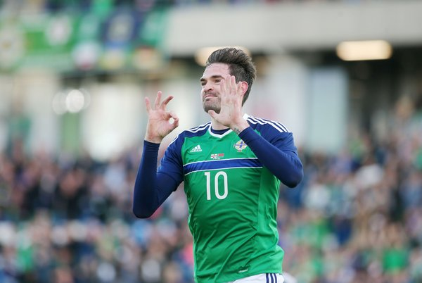 Lafferty wheels away in celebration after scoring on his 50th appearance for Northern Ireland | Photo: Getty