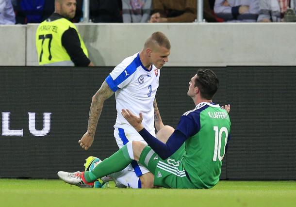 Lafferty and Skrtel clash during the first half | Photo: Getty