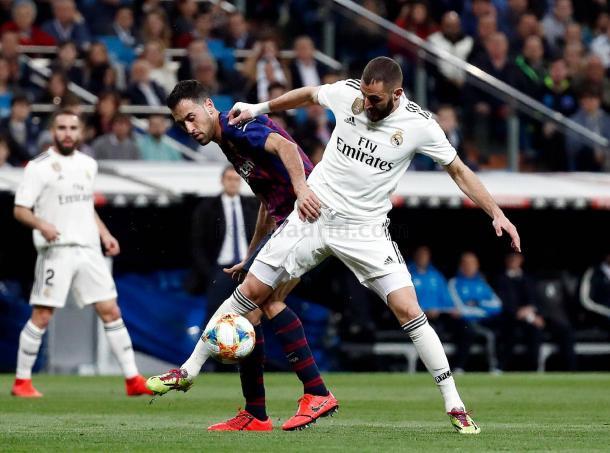Benzema y Busquets durante el partido del miércoles | Foto: Realmadrid.com