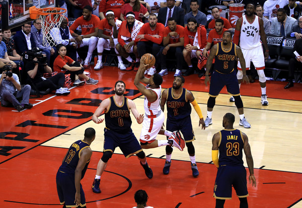 Toronto Raptors' guard Kyle Lowry (7) goes up for a shot with no Cleveland Cavaliers player contesting the shot. Photo:
