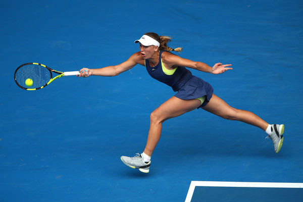 Photo: Clive Brunskill/Getty Images AsiaPac-Caroline Wozniacki hits a forehand winner.