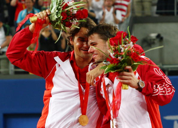 Federer and Wawrinka celebrate winning the gold for their native country of Switzerland in the 2008 Olympics men's doubles competition. Credit: Clive Brunskill/Getty Images