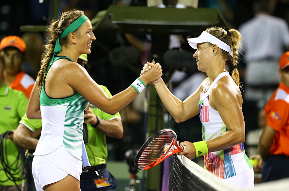 Kerber and Azarenka meet at the net after their semifinal in Miami (Getty/Clive Brunskill)