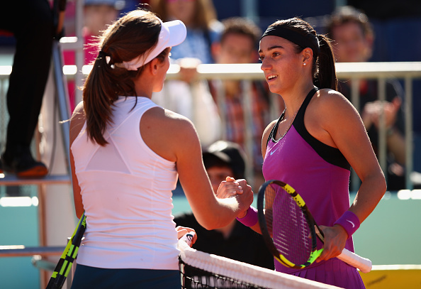 Caroline Garcia talks to Johanna Konta after the Brit retired in Madrid (Getty/Clive Brunskill)
