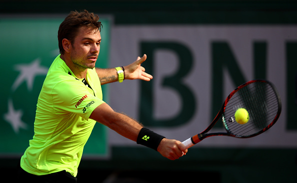 Wawrinka just reaches the backhand in time in his victory over Jeremy Chardy of France. Credit: Clive Brunskill/Getty Images