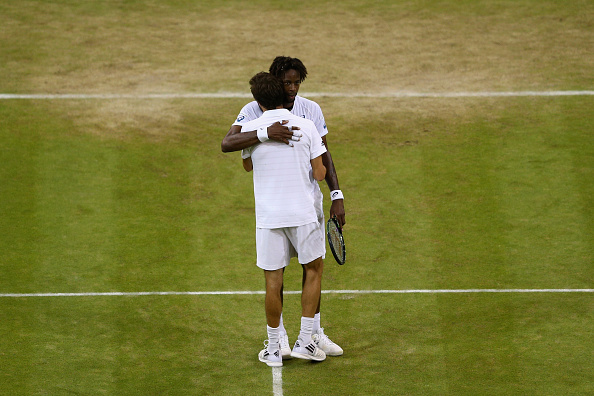 Gael Monfils embraces Gilles Simon after their epic Wimbledon third round clash in 2015 (Getty/Clive Brunskill)