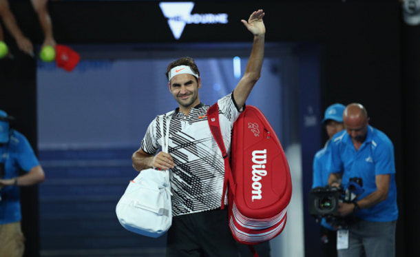 Federer thanks the crowd on Rod Laver Arena after the late-night victory. Credit: Clive Brunskill/Getty Images