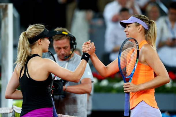 Bouchard and Sharapova meet at the net following their match in Madrid (Getty/Clive Rose)