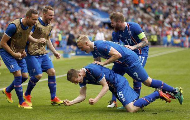 The Icelandic squad wheel away in celebration, after Böðvarsson puts them ahead. | Credit: Uefa