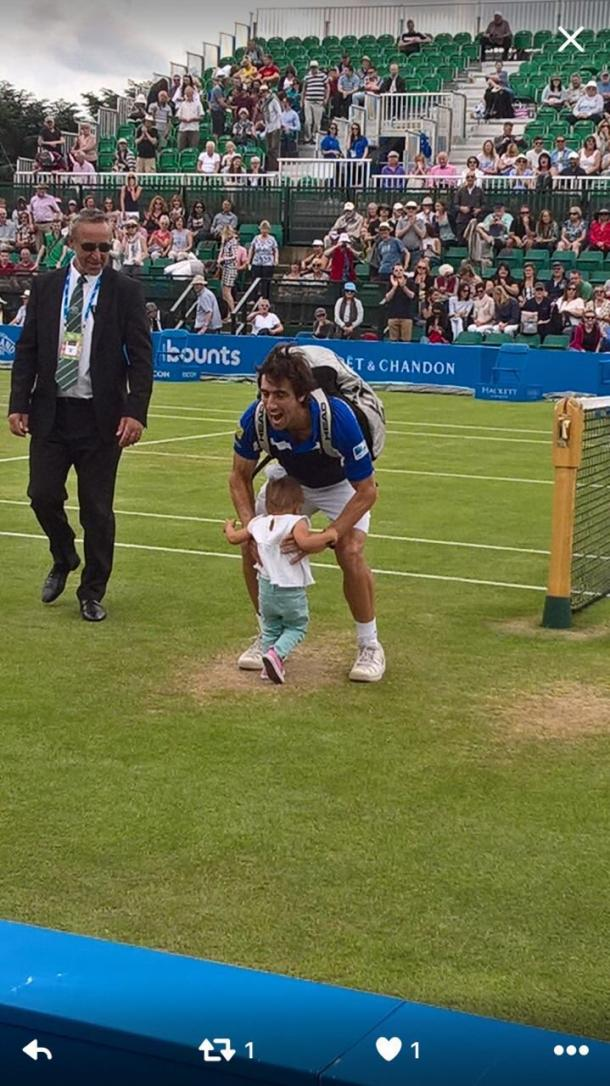 Cuevas shares a special moment with his daughter after victory. Photo: Getty