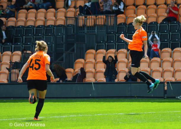 Jo Wilson celebrates giving the London Bees the lead against Chelsea in a Conti Cup game - the Bees went on to win the tie on penalties (Credit: Gino D'Andrea)