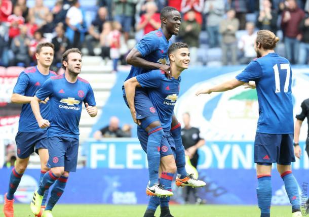 Jogadores comemoram gol de Andreas Pereira | Foto: John Peters/Man United/Getty Images)