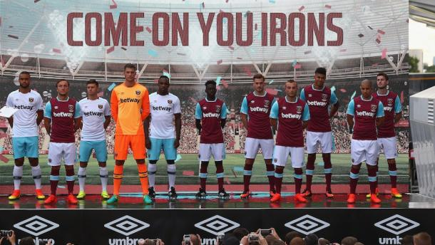 Above: Michail Antonio and other West Ham United players unveiling the club's new kits | Photo: whufc.com
