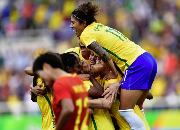 Brazil celebrate Monica's header. (Photo: FIFA)