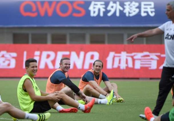 Rooney smiling during training in China | Photo: Getty
