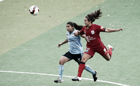 Colaprico (right) wins a header in a W-League game | Source: Matt King - Getty Images