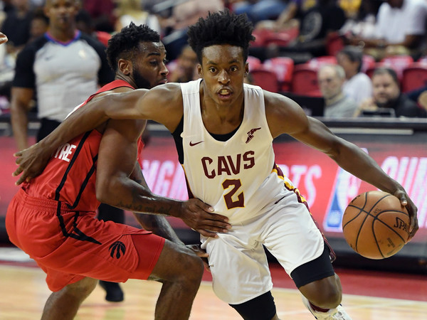 Collin Sexton #2 of the Cleveland Cavaliers drives against Codi Miller-McIntyre #11 of the Toronto Raptors during a quarterfinal game of the 2018 NBA Summer League. |Ethan Miller/Getty Images North America|
