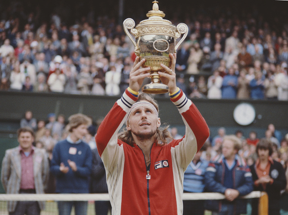 Borg holds his trophy after winning his third straight Wimbledon crown. Photo: Fox Photos/Getty Images