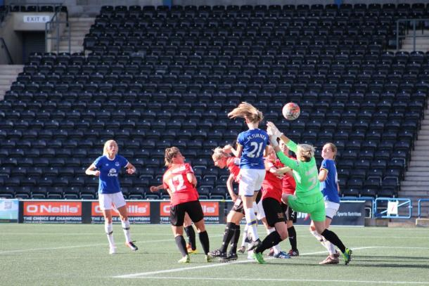 Turner's header beats Draycott to give Everton the lead (Credit: Everton Ladies)