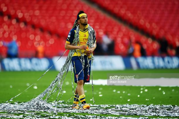 Celebrating one of two FA Cups in Arsenal colours. Source | Getty Images.