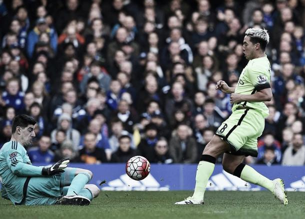 Above: Thibaut Courtois saves from Samir Nasri in Chelsea's 2-0 defeat to Manchester City | AP