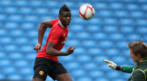 Pogba in his early days in a United shirt | Photo: Getty