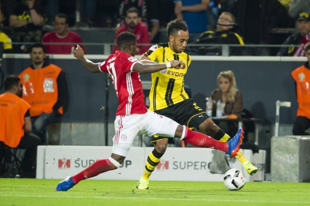 Aubameyang does battle with Alaba in the first half | Photo: Getty