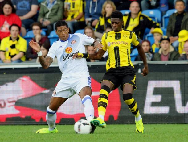 Above: Patrick Van Aanholt going in for the tackle in Sunderland's 1-1 draw with Borussia Dortmund | Photo: safc.com