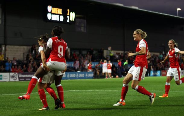 Fara Williams is mobbed by teammates after netting a dramatic winner. (Photo: Arsenal LFC)