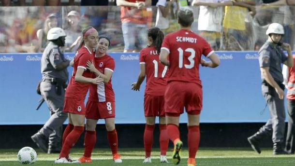Janine Beckie is congratulated by teammates as Canada celebrate taking the lead against Zimbabwe. (Photo: The Chronicle Herald)