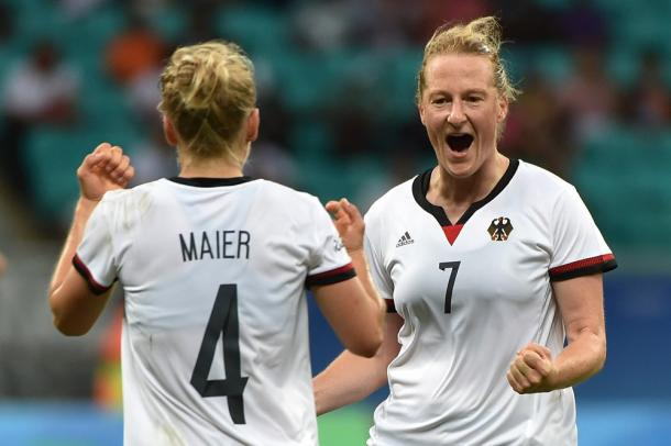 Behringer and Maier celebrate after the former broke the deadlock. (Photo: FIFA)
