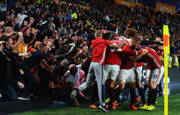 The United players celebrate with the fans after Rashford nets the winner | Photo: Getty