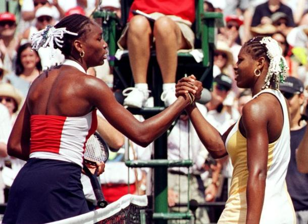 Serena congratulates her sister Venus on winning the tournament in 1999. Credit: Credit Rhona Wise/Agence France-Presse — Getty Images