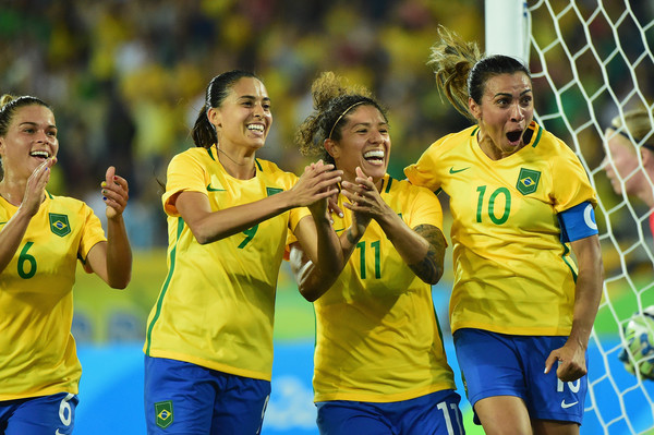 Cristiane celebrates her goal against Sweden with her teammates. it was her record 14th career tally in Olympic competition/Photo: Harry How/Getty Images