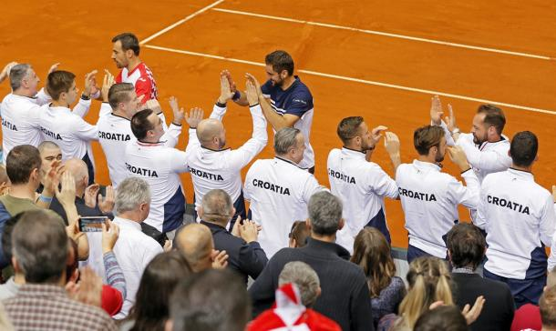 The Croatian team celebrates taking a 2-1 lead into day three of their first round tie. Photo: Predrag Milosavljevic/Davis Cup