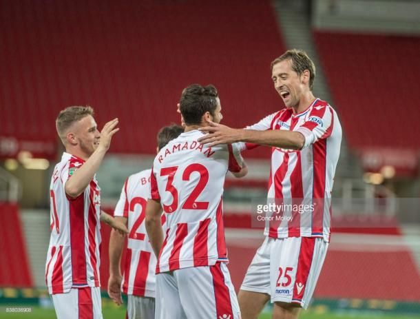 Peter Crouch celebrates with Ramadan Sobhi. Source | Getty Images.