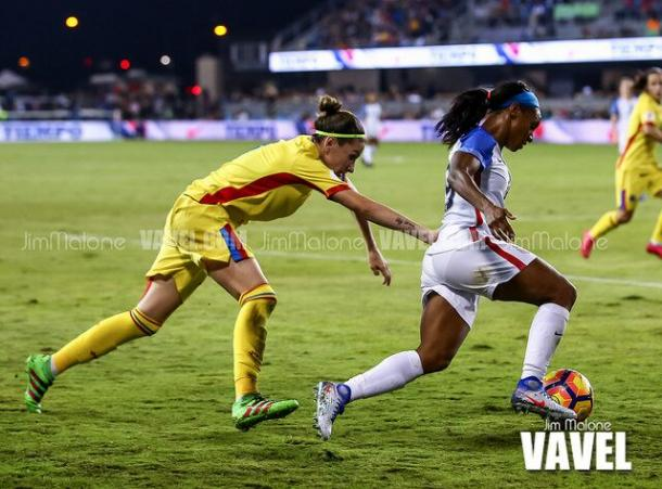 Crystal Dunn, playing with the USWNT, on the attack. | Photo: Jim Malone