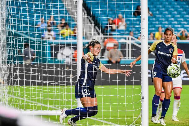 Kaleigh Kurtz and Lynn Williams can only watch as a shot from Lyon goes off the post. | Photo: Jonathan Willey