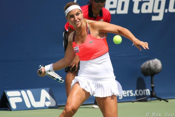 Dominika Cibulkova hits a forehand | Photo: Max Gao / VAVEL USA Tennis