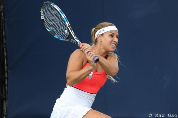 Dominika Cibulkova in action during her doubles match | Photo: Max Gao / VAVEL USA Tennis