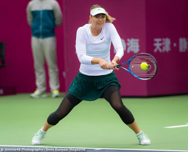 Maria Sharapova hits a backhand at the Tianjin Open | Photo: Jimmie48 Tennis Photography