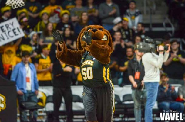 UMBC's mascot True Grit on the floor during a break in the action