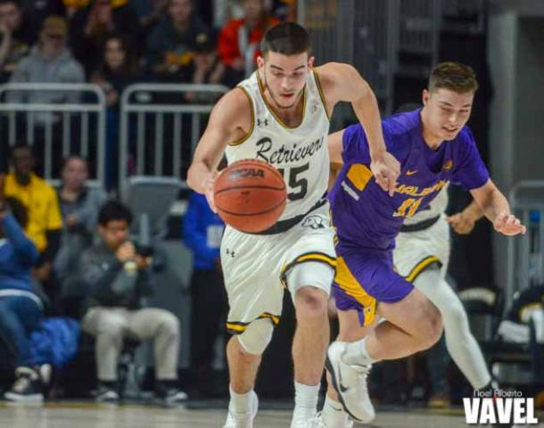 Jose Placer of UMBC racing off to the basket after he steals the ball