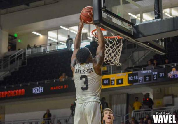UMBC's KJ Jackson dunking during the second half of their win against Albany