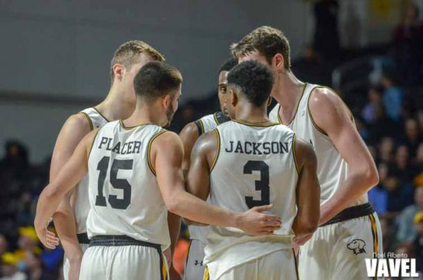 UMBC players huddle after a foul by Albany late in the game