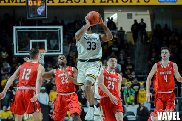 UMBC's Arkel Lamar with a last second heave before the half